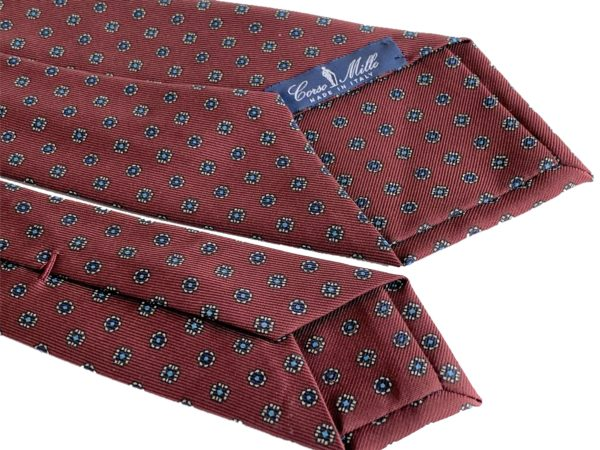 3-fold burgundy with sky blue and white motif tie